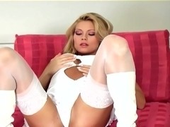 Glamour babe rubs her pussy in boots and stockings