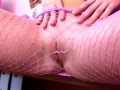 Pigtailed brunette in sexy pink fishnet pantyhose