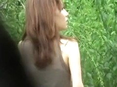 Asian babe texting in the park got a kinky street sharking.
