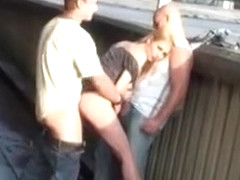 Julie Silver gives public blowjob for two men