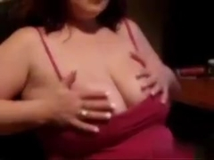 I'm a busty amateur sex bomb with red hair, who is fondling her massive bazongas in this sexy vide.