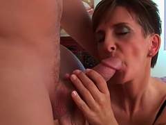 Soccer mom in black stockings and lingerie gets drilled hard