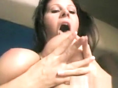 Gianna Michaels squeezes tits