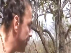 African Slave Gives Master Blowjob Outdoors