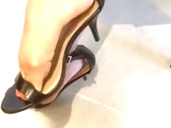 Friend Toe tapping in kitchen, kitten heeled sandals with red toes ;)