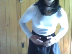Cute in black skirt and white outfit posing and riding dildo