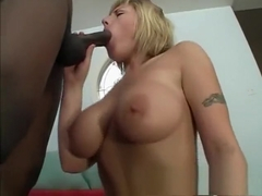 Buxom blonde cougar screams with pleasure while fucking a black stick
