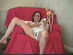 clair wanking with black dildo and double strap-on