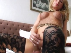Ts Camille Andrade beats her huge cock until she unloads cum