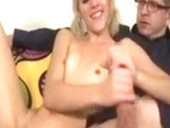 Petite blonde girl wanking a cock