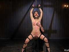 Brunette in device bondage pussy toyed