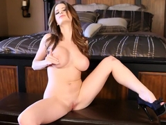 Brunette beauty Emily Addison plays with her pussy