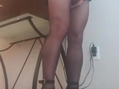 Crossdresser in Strappy Heels and Crotchless Pantyhose