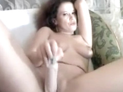 Tan milf is slowly undressing and having fun with a mobile