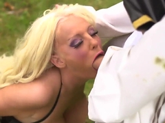 Truly gorgeous Dolly Partem is giving deepthroat blowjob!