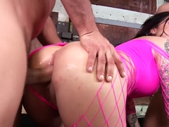 Tattooed slut in pink lingerie Karmen Karma fucks two cocks at once