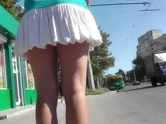 Alluring blond caught by upskirt web camera