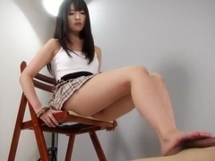 Japanese cute girl doing a footjob