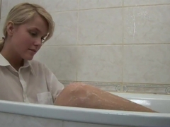 Teen blondie in a bath tub