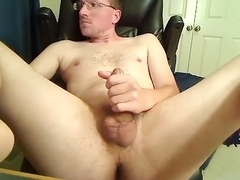 Charming homosexual is jerking in the bedroom and shooting himself on camera