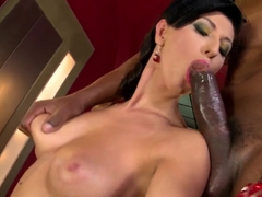 Gentle hot brunette chick Emylia Argan is doing naughty blowjob to her strong and giant cocked bla.