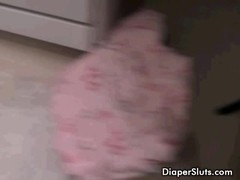Young slut driking piss from diaper