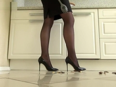 Lena crushing roaches in sharp heels.