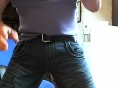 Pissing and bulging in taut jeans
