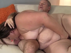 Fat, sexy Bella Bendz does an older guy on a white sofa