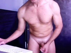 Sexy gay is beating off in the guest room and shooting himself on camera