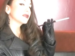 Leather Lady Smokin' and Enjoying Her Leather