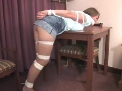 Girl with blouse and short skirt bound and gagged