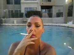 Hot Babe Swimming and having a 120 Smoke