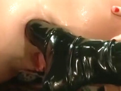 Gape queen Roxy Raye takes two feet up her ass