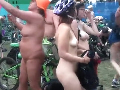 Ambitious men and women riding their bikes naked