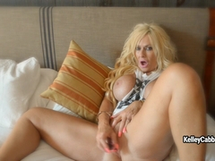 Busty mature Kelley Cabbana toys her wide cunt with pink dildo