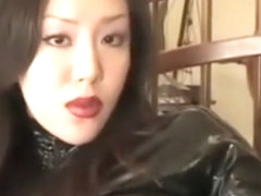 Asian Latex Dominatrix Pegging Her Gimp