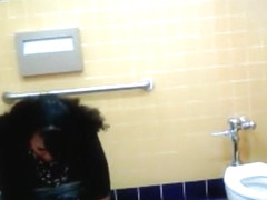 Lovely Brazilian fattie gets recorded urinating hard in a public restroom