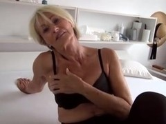 Beautiful granny strips off her clothes