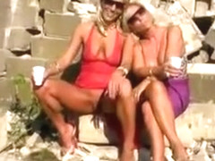 Blondes piss on slave men in kinky outdoor scene