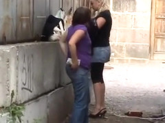 Two Ukrainian girls caught peeing outdoors