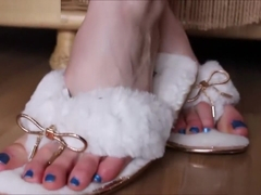 Princess Skyla dangles her sexy fluffy house slippers