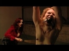 Redhead domina gives some spanking to her serf
