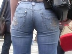 Tight jeans perfectly fit her beautiful ass and legs