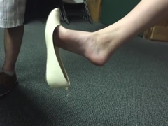 Amazing feet in flats dangling w/ shoe drop