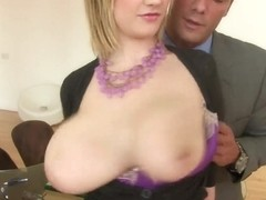 A big titted slut sucks dick at the office