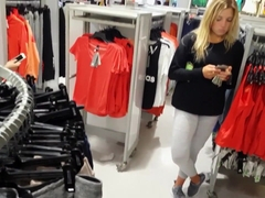 Candid voyeur hot blonde in leggings shopping