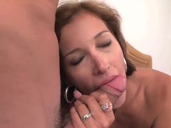 A kinky MILF sucks and jerks a muscular guy