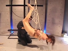 Lovely Asian brunette gets tied up and suspended