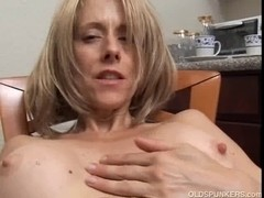 Excited aged honey with large teats rubs her moist vagina for